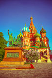 Statue of Minin and Pozharsky against the background of St. Basil`s Cathedral in Moscow. On Red Square Stock Image