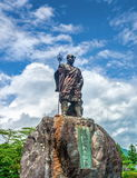 Statue of Monk Shodo Shonin in front of Rinnoji temple with cloudy sky background, Nikko, Tochigi, Japan. NIKKO, JAPAN - SEPTEMBER 06, 2012: Statue of Monk Shodo Royalty Free Stock Images