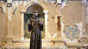 Statue of monk in Spanish church stock photography