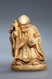 Statue of a monk with a stick Stock Image