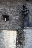 Statue of Monk in Tallinn Royalty Free Stock Image