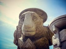 The statue is a monument of a stone lion in Thailand stock photo