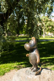 The statue of Moomintroll, Mumipeikko in Sorsapuisto park. The Moomins Muumit are written by Tove Jansson and illustrated by Lars Jansson in finnish and stock photos