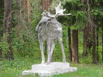 Statue Moose old and large in the forest. stock photo