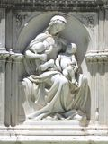 Statue of mother with babies, Siena, Italy Royalty Free Stock Photography