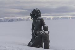 Statue of mother and child at Nordkapp. The statue representing a mother with her child that can be seen at Nordkapp here in the winter season with plenty of Royalty Free Stock Image