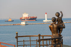 Statue of mother and son greeting the sailor on the pier. Odessa Stock Images