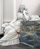Statue of a Mourning Lady inside a Danish Church. Statue of a Mourning Lady in Her Grievance Royalty Free Stock Photos