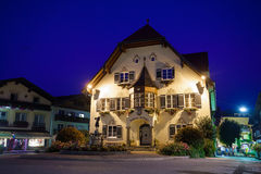 Statue of Mozart and townhall at night in St. Gilgen Stock Photo