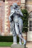 Statue of a musician playing flute, Powis castle garden, UK Royalty Free Stock Photography