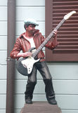Statue musician. Playing guitar Royalty Free Stock Photo