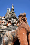 Statue of a mythical animal on the background of the temple in Myanmar Stock Photo