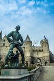 The statue of the mythical giant, Lange Wapper, outside the Het. Steen or Stone Castle, in Antwerp, Belgium Stock Photo