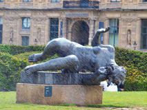 Statue of a naked woman magnificent forms being sprayed with water Royalty Free Stock Image