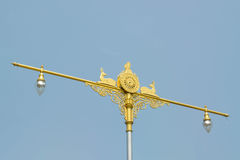 Statue of native thai art with street lamps on blue sky backgrou Stock Photo