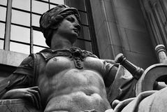 Statue of Navigation. A topless statue representing the concept of Navigation, at the old Port of London Authority, Trinity Square Gardens, London Stock Photos