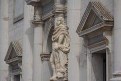 Statue near the church Royalty Free Stock Photo