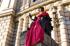 Statue near the Opera House in red cloth, Prague, Royalty Free Stock Image