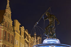 Statue of Neptune decorating the Old Square of Gdansk Stock Images