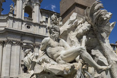 Statue of Neptune from Famous Fountain of the Four Rivers with a Royalty Free Stock Photos