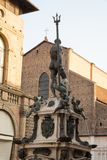 Statue of Neptune the giant in Piazza Maggiore, with the church of San Petronio, Bologna Italy . royalty free stock photos