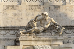 Statue of Neptune at the Monument of Victor Emmanuel II at Piazza Venezia in Rome Stock Photo