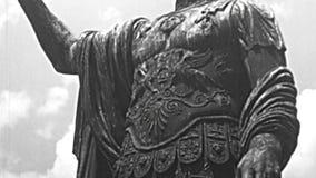 Statue of Nerva Caesar emperor in Rome. Statue of Marco Cocceio Nerva Caesar Augustus, Roman emperor Caesar in Imperial Forums road of Rome. BW historical stock video
