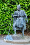 A statue of a New Zealand Maori chief in traditional dress. This statue in Waihi, New Zealand, is of a legendary Maori chief, dressed in a traditional cloak. He royalty free stock images