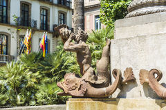 Statue of newt playing a horn, Barcelona Royalty Free Stock Image