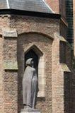Statue next to Oude Kerk Delft Royalty Free Stock Photos