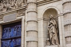 Statue Next To The Main Portal Of The Parish Church Of Saint-Etienne-du-Mont, Montagne Sainte-Genevieve, Paris, France Stock Image