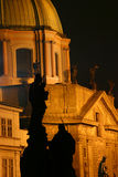 Statue in the night. Shadow of a statue from Charles Bridge in front of a nearby historic building (Prague Stock Photos