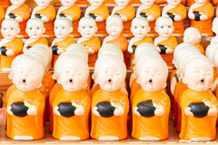 Statue of novices at thai temple.  Royalty Free Stock Photo