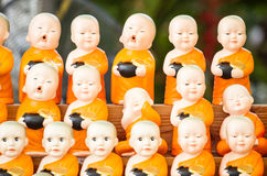 Statue of novices at thai temple Stock Images