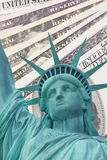Statue Of Liberty And Dollars Background Royalty Free Stock Images
