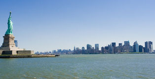 Statue Of Liberty & Manhattan Stock Image