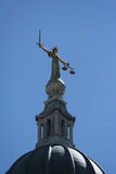 Statue at Old Baily court. Golden statue on top of Old Baily criminal court, London Royalty Free Stock Photos