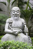 Statue of old Chinese man in garden, Hong Kong Stock Images