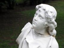 Statue in old garden Stock Image