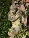 Statue. Old statue of gnome in garden Stock Photography