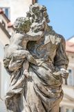 Statue of old priest with baby at Old Town in Prague, Czech Repu Stock Image