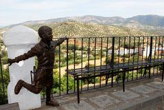 Statue and olive groves, Priego de Cordoba. Stock Image