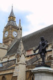Statue of Oliver Cromwell and Big Ben. Statue of Oliver Cromwell at Westminster and Big Ben Clock Tower in London. Oliver Cromwell – is english revolutionary Stock Photo