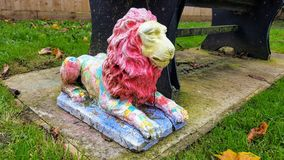 Lion. Statue of one lion with a broken leg Stock Photography