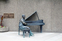 Statue of Oscar Peterson. Musical statue of Oscar Peterson in Ottawa near the concert hall stock photography