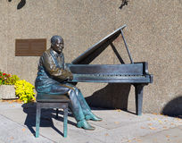 Statue of Oscar Peterson. OTTAWA, CANADA - 12TH OCTOBER 2014: A statue of Oscar Peterson during the day stock images