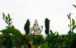 Statue on Other Side of Green Trees royalty free stock photography