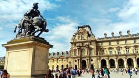 A statue outside Louvre stock images