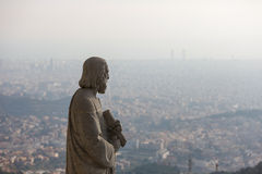 Statue over the city Royalty Free Stock Images