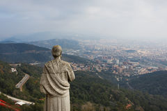 Statue over the city Stock Images